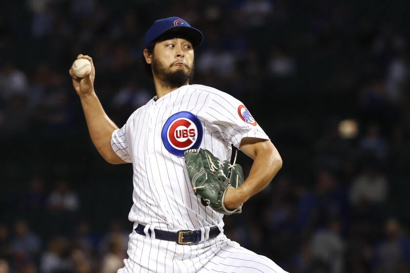 FILE - In this Sept. 17, 2019, file photo, Chicago Cubs starting pitcher Yu Darvish delivers during the first inning of a baseball game against the Cincinnati Reds, in Chicago. Starting pitcher Darvish and outfielder Jason Heyward are staying with the Chicago Cubs, who exercised their $11.5 million option for 2020 on left-hander José Quintana on Saturday, Nov. 2, and declined their $6.5 million option on lefty Derek Holland, which triggered a $500,000 buyout.(AP Photo/Charles Rex Arbogast, File)