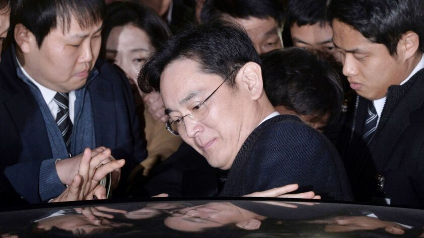 Lee Jae-yong, vice chairman of Samsung Electronics Co., gets into a car to leave after attending a hearing at the Seoul Central District Court in Seoul, South Korea, on Feb. 16, 2017.