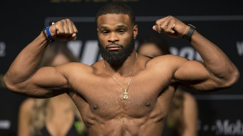 Tyron Woodley poses during the UFC 209 weigh-in event with his opponent Stephen Thompson, not pictur
