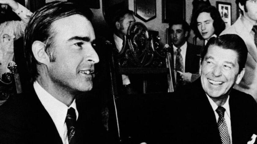 Then-Gov.-elect Jerry Brown meets with his outgoing predecessor, Ronald Reagan, in Sacramento on Nov. 8, 1974.