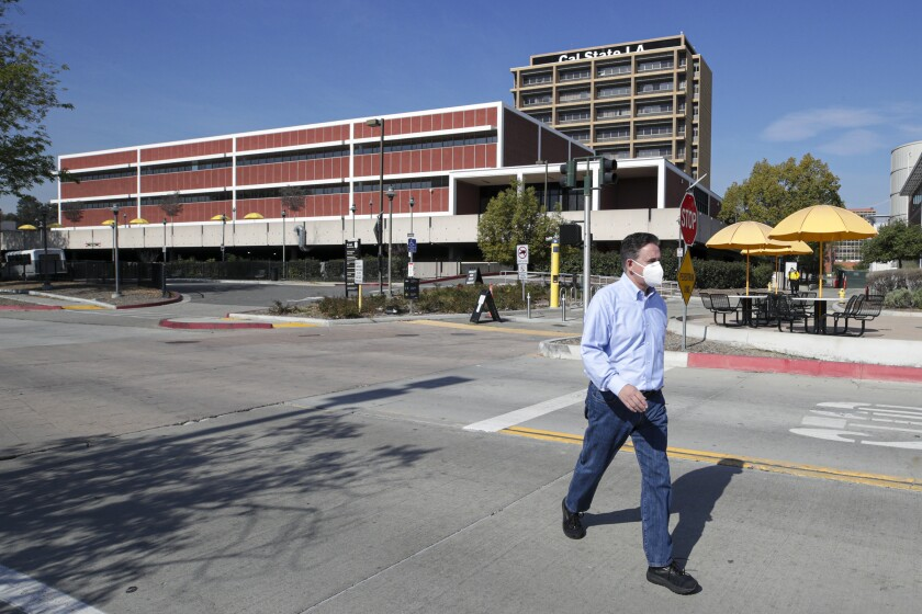 Man walks on the Cal State Los Angeles campus.