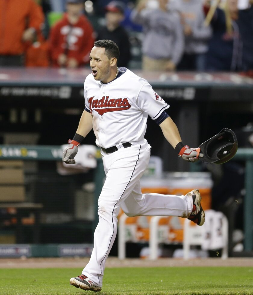 Cleveland Indians' Asdrubal Cabrera runs the bases after hitting a game-winning three-run home run off Boston Red Sox relief pitcher Edward Mujica in the 12th inning of a baseball game, Thursday, June 5, 2014, in Cleveland. Mike Aviles and Michael Bourn scored. The Indians defeated the Red Sox 7-4 in 12 innings. (AP Photo/Tony Dejak)