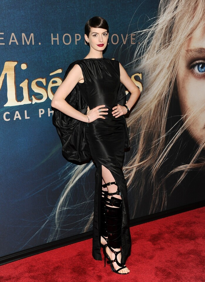 """Anne Hathaway, who plays Fantine in """"Les Miserables,"""" arrives for the New York premiere of the film at the Ziegfeld Theatre."""