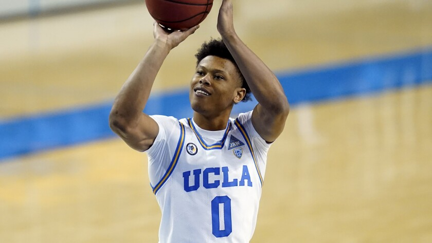 UCLA guard Jaylen Clark takes a shot during the second half against Washington on Saturday at Pauley Pavilion.