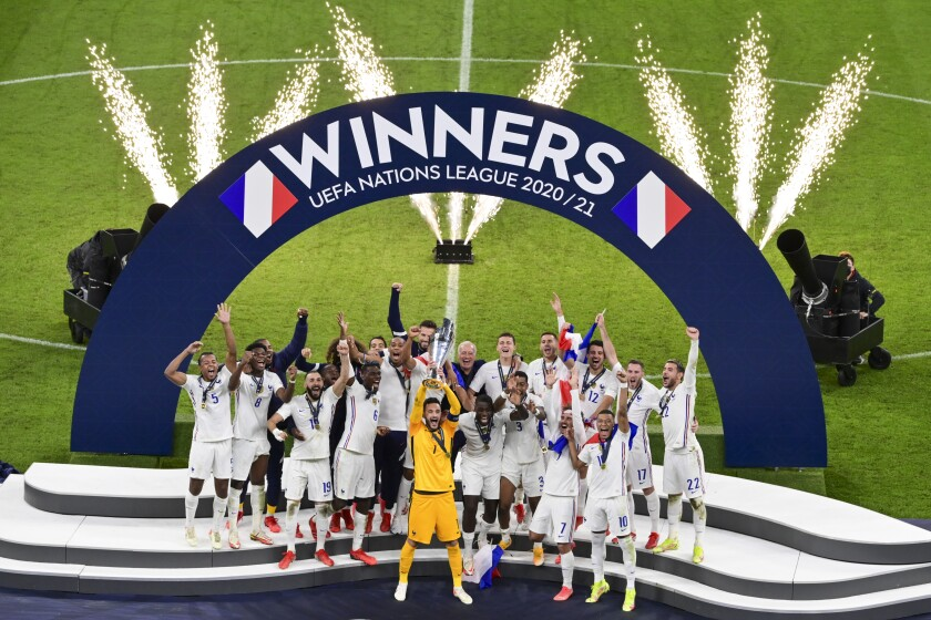 French players react with their trophy after defeating Spain to win the UEFA Nations League final soccer match at the San Siro stadium, in Milan, Italy, Sunday, Oct. 10, 2021. (Miguel Medina/Pool Photo via AP)