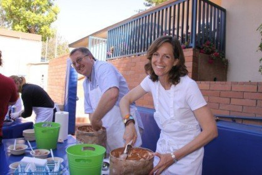 Parents Don Carlson and Karen Stone help serve ice cream.