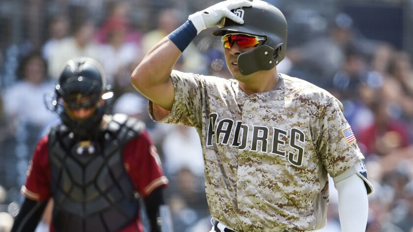 The Padres' Christian Villanueva reacts after a called strike out during the sixth inning of a baseball game against the Arizona Diamondbacks at Petco Park on July 29, 2018 in San Diego, California.