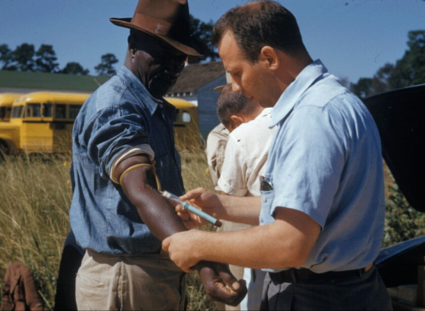 A man included in the syphilis study received an injection in the 1950s in Tuskegee.