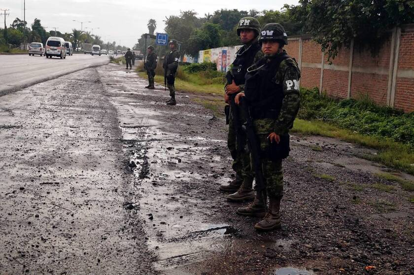 """Mexican troops are among the federal forces who have taken over control of Lazaro Cardenas port from municipal police. A government spokesman said officials had received tips about """"acts of corruption"""" and collusion with drug cartels."""