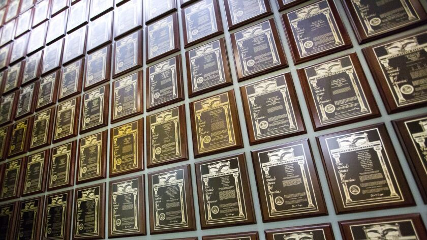 A wall in the headquarters of Ionis Pharmaceuticals displays some of the more than 1,000 patents it has been awarded.