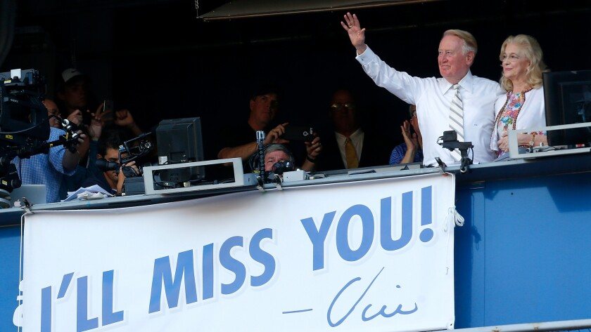 Dodgers announcer Vin Scully, with wife Sandra Hunt, after the team's tenth-inning victory over the Rockies on Sept. 25 at Dodger Stadium in Los Angeles.