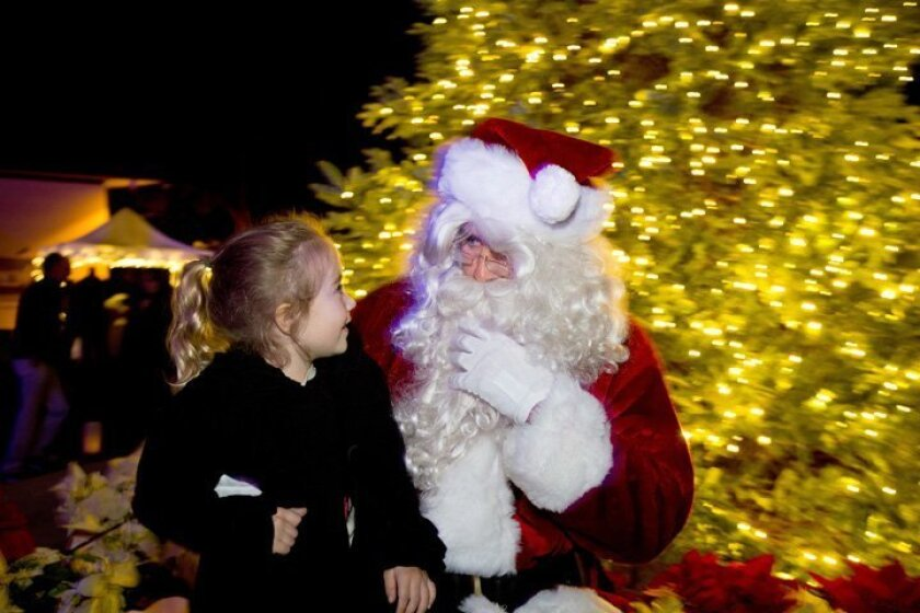 Santa meets with a young admirer at The Bishop's School Christmas Tree Lighting gathering.
