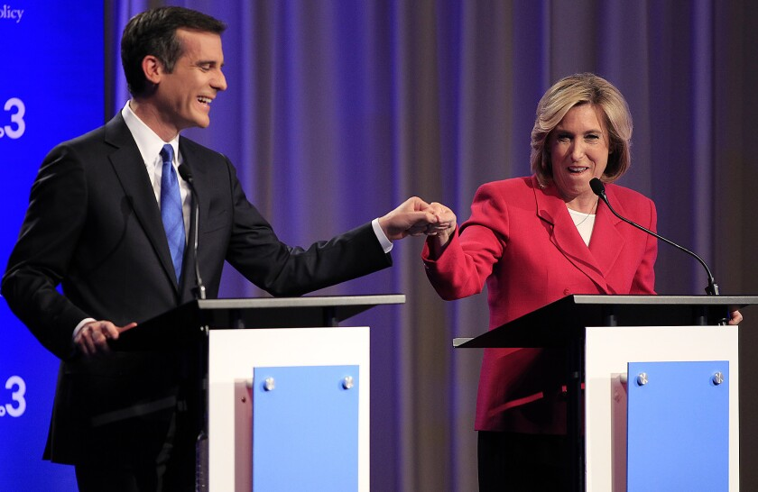 Wendy Greuel and Eric Garcetti prepare to debate at USC last month. Organized labor has put more than six times as much money into the effort to elect Greuel than it has placed toward Garcetti's bid.