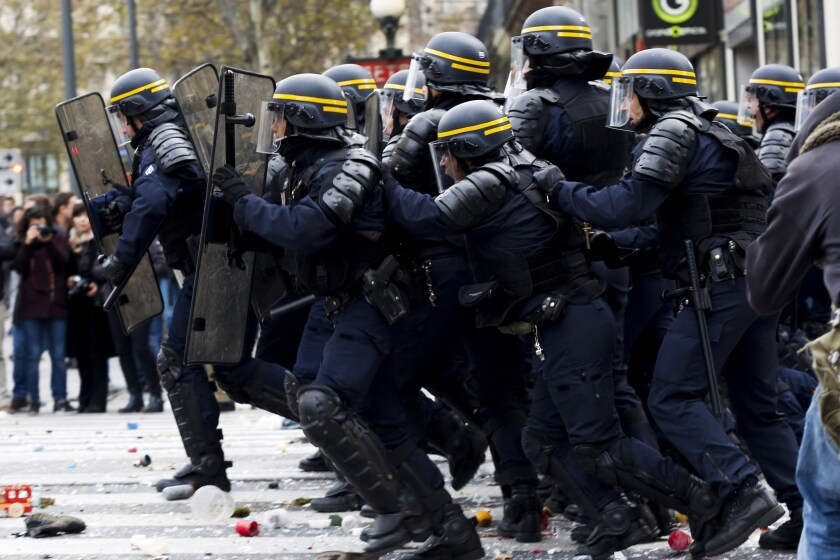 Protesters clash with riot police in Paris on Nov. 29 during a rally that demanded action on climate change.