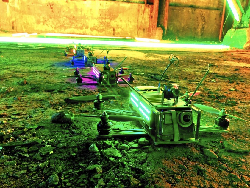 In a drone league experiment, quadcopters are lined up before a race at an abandoned power plant in Yonkers, N.Y.