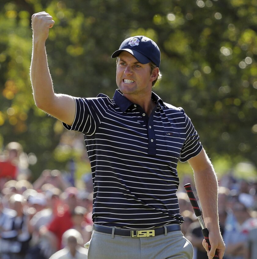FILE - In this Sept. 29, 2012, file photo, USA's Webb Simpson reacts after making a putt on the 11th hole during a four-ball match at the Ryder Cup PGA golf tournament at the Medinah Country Club in Medinah, Ill. Ryder Cup captain Tom Watson announces his wild-card selections for the American team, Tuesday, Sept. 2, 2014, with Keegan Bradley, Hunter Mahan, Webb Simpson and Chris Kirk among the favorites. (AP Photo/Charlie Riedel, File)