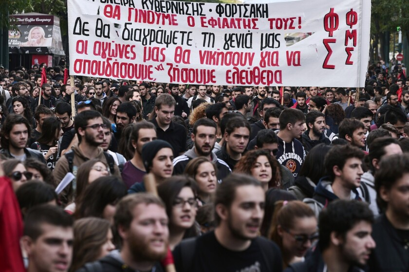 "High school and universities students hold a banner reading ""You won't delete our generation -- our struggle will win and we will study and live freely"" during a march in central Athens on Nov. 6, 2014, to protest a teacher shortage and layoffs of universities' administrative staff."
