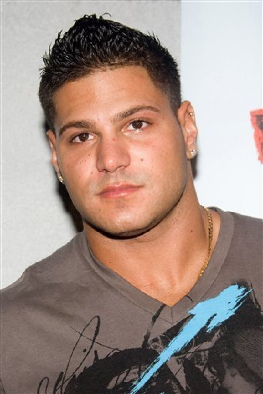 FILE - In this July 13 2010 file photo, Ronnie Ortiz-Magro arrives at the Jersey Shore Soundtrack Release Party in New York. Ortiz-Magro has been admitted into a pretrial intervention program that will allow him to avoid a criminal record for an assault that was shown on the first season of the MTV reality series. The 25-year-old New York City resident appeared Monday, July 11, 2011, in New Jersey Superior Court in Toms River. (AP Photo/Charles Sykes, File)