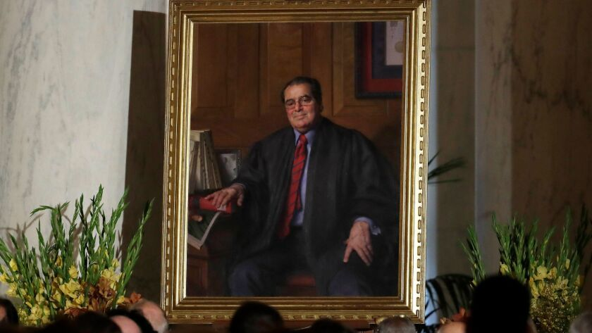 A portrait of the late Supreme Court Justice Antonin Scalia is displayed during a memorial