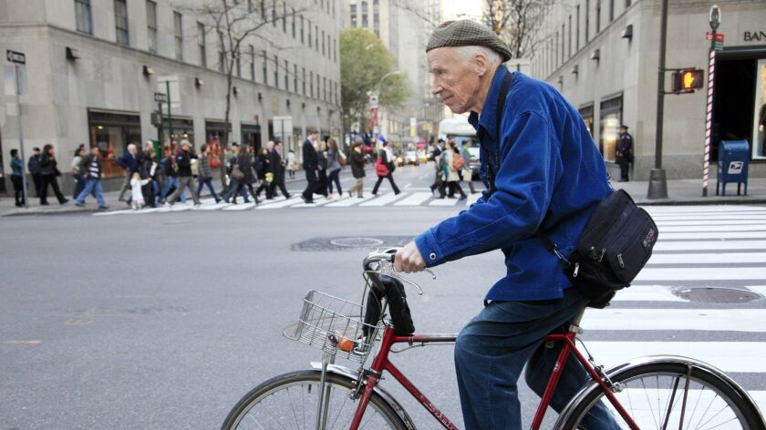 "Bill Cunningham bicycling in New York in 2010. In ""Fashion Climbing"" he celebrates clothes, the women who inspired him and dishes delightfully on the New York social scene."