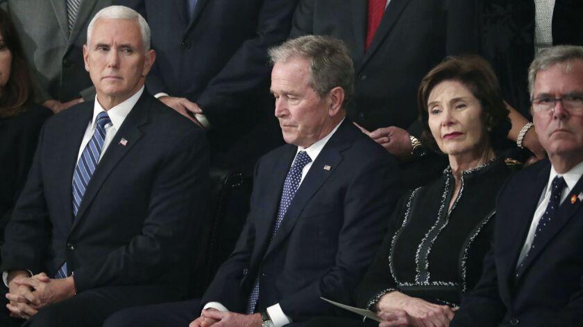 Former President George W. Bush, second from left, former first lady Laura Bush, former Florida Gov.
