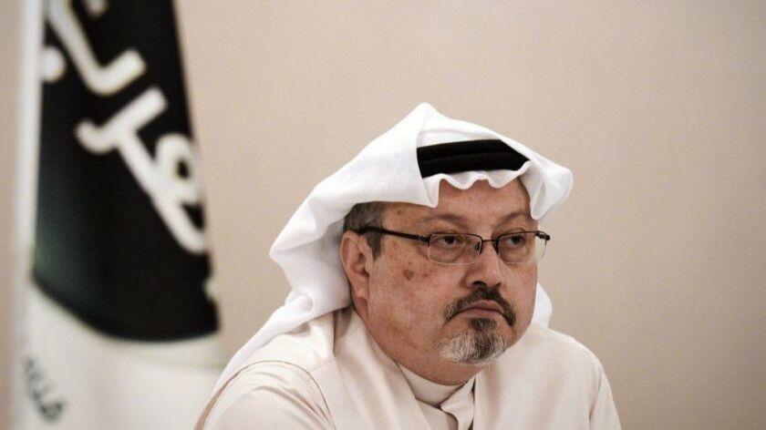 Journalist Jamal Khashoggi looks on during a news conference in the Bahraini capital, Manama, in 2014.
