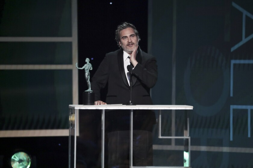 Joaquin Phoenix accepts his SAG Awards trophy. What will he say if he wins the Oscar?