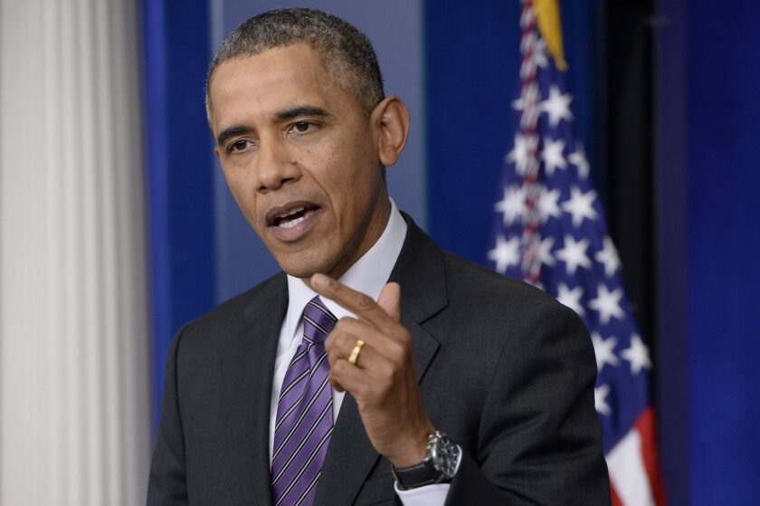 President Obama speaks about his healthcare law, the Affordable Care Act, at a news conference.