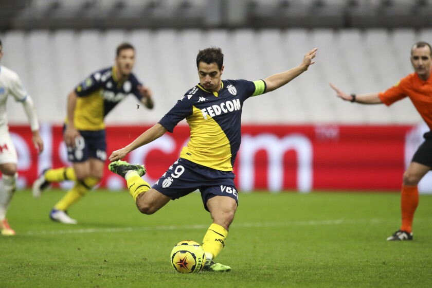 Monaco's Wissam Ben Yedder shoots a penalty kick to score his side's first goal during the French League One soccer match between Marseille and Monaco at the Stade Velodrome in Marseille, southern France, Saturday Dec. 12, 2020. (AP Photo/Daniel Cole)