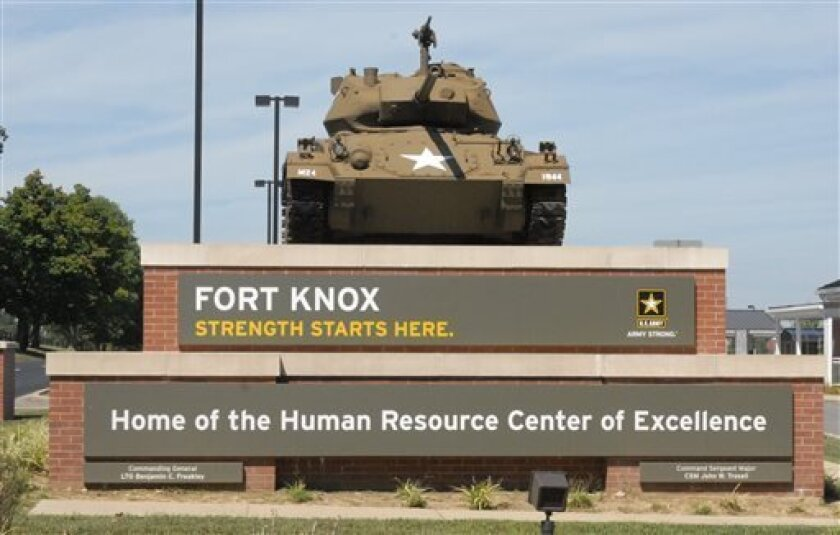 This Aug. 18, 2010 image provided by the U.S. Army shows the Chaffee Gate entrance to Fort Knox. An Army civilian employee was shot and killed in a parking lot at Kentucky's Fort Knox on Wednesday, and investigators were seeking to question a man in connection with the shooting, authorities said. Army officials said in a news release late Wednesday April 3, 2013 that the victim was an employee of the U.S. Army Human Resources Command, which handles personnel actions for soldiers. The shooting oc