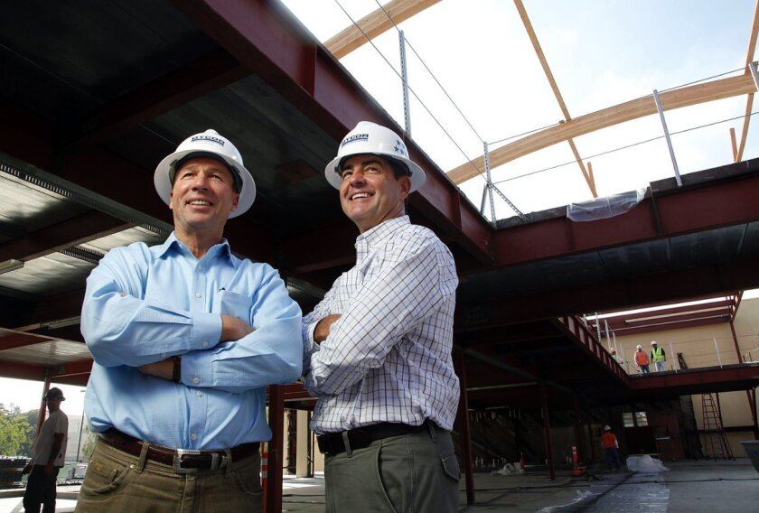 Bycor President Rich Byer, left, and CEO Scott Kaats at High Tech elementary school construction site at Liberty Station in Point Loma.