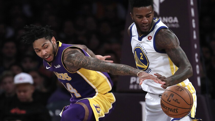 The Lakers' Brandon Ingram, left, and the Warriors' Jordan Bell vie for a loose ball.