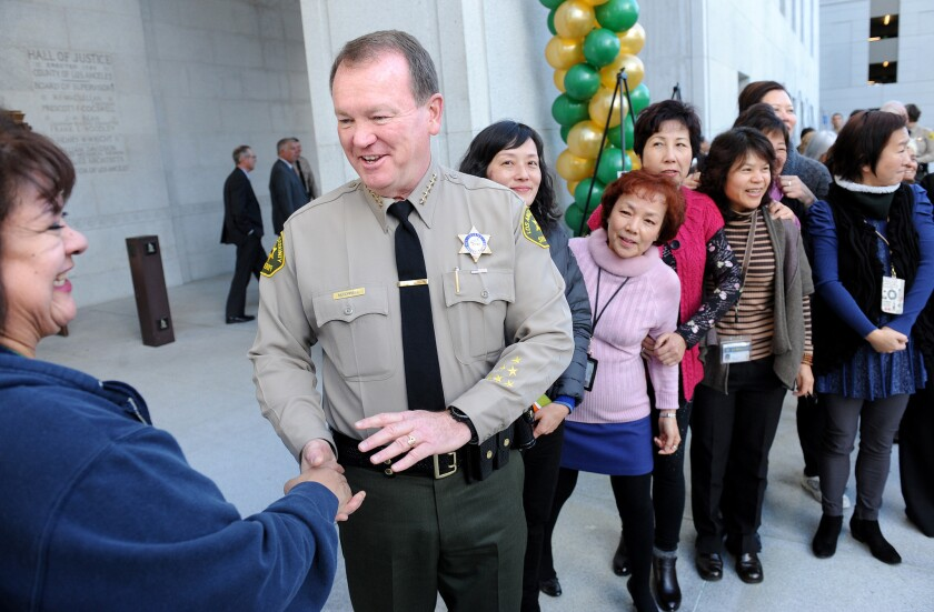L.A. County Sheriff Jim McDonnell is congratulated during his first anniversary celebration at the Hall of Justice in downtown Los Angeles on Dec. 1, 2015.