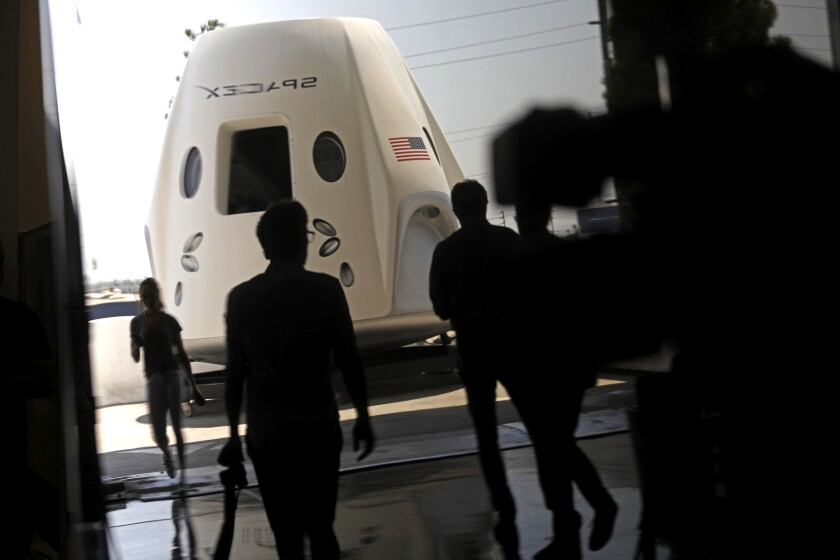 A prototype of SpaceX's Crew Dragon spacecraft is displayed at the company's headquarters in Hawthorne in 2018.
