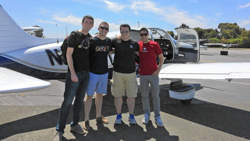Flytenow co-founder Matt Voska, third from left, and passengers Steve McHugh, left, Zac Campbell and Greg Skloot prepare to depart from Palo Alto Airport on a trip to Monterey. Voska, a private pilot, said the passengers used the firm's online service to find his flight.