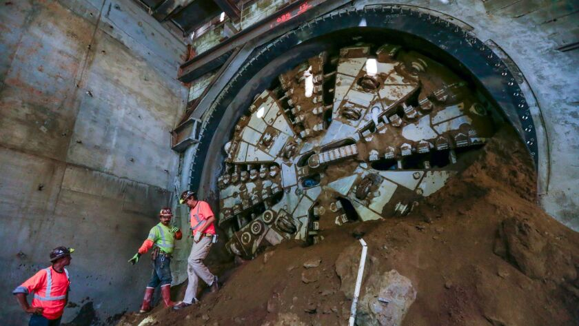"""""""Harriet,"""" a tunnel-boring machine on the Crenshaw/LAX light rail construction project, breaks through at the underground Leimert Park Station."""