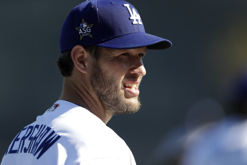 Dodgers pitcher Clayton Kershaw looks on during a spring training practice on Feb. 20.