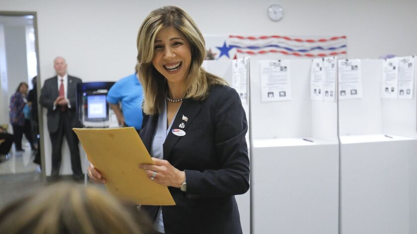 District Attorney Summer Stephan drops her mail in ballot off at the San Diego County Registrar of Voters office in Kearny Mesa, Tuesday morning. Stephan won easily, as did Sheriff Bill Gore. Photo by Howard Lipin/San Diego Union-Tribune