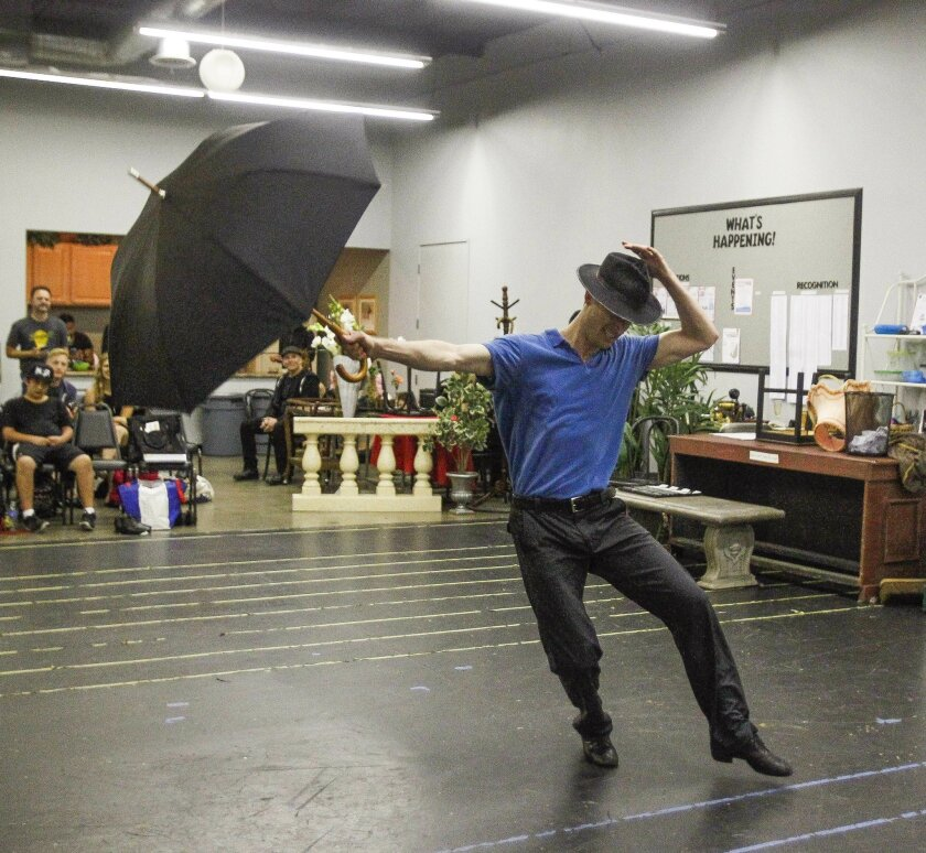 "Brandon Davidson, who plays Don Lockwood, rehearses a scene from San Diego Musical Theatre's ""Singin' in the Rain."""