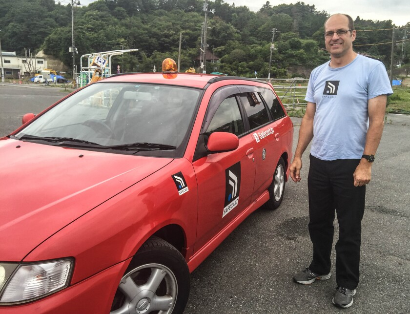 Joe Moross has driven 90,000 miles gathering data for Safecast. A Geiger counter equipped with a GPS module hangs from the back window of his station wagon.