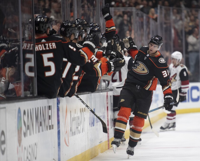 Ducks center Derek Grant is congratulated for his goal during the first period against the Arizona Coyotes on Thursday at Honda Center.