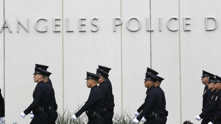 An LAPD recruit officer class marches during graduation exercises outside the department headquarters in downtown L.A.