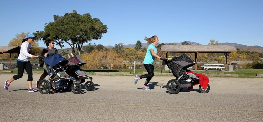Stroller Warriors Melanie Cain, Dao Hawkins and Christina Ritch on a run at Camp Pendleton. Photo by Cpl. Sarah Wolff-Diaz