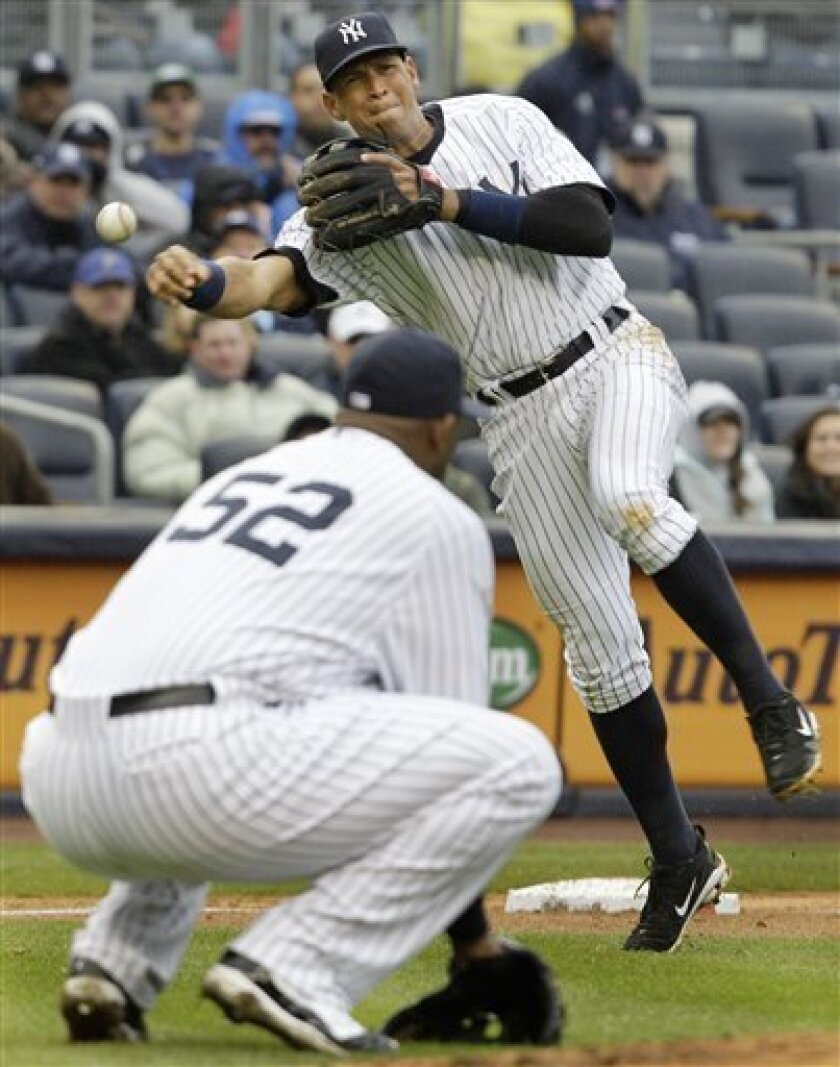 New York Yankees starting pitcher CC Sabathia squats so third baseman Alex Rodriguez can throw out Detroit Tigers  Victor Martinez at first in their opening day baseball game at Yankee Stadium on Thursday, March 31, 2011 in New York. (AP Photo/Kathy Willens)