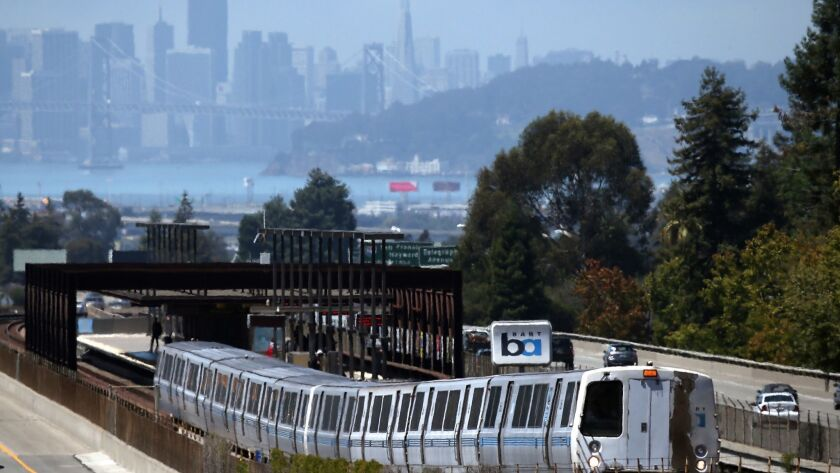 A Bay Area Rapid Transit train pulls away from the Rockridge station in Oakland. The transit district has been accused of using public resources to promote a bond measure.