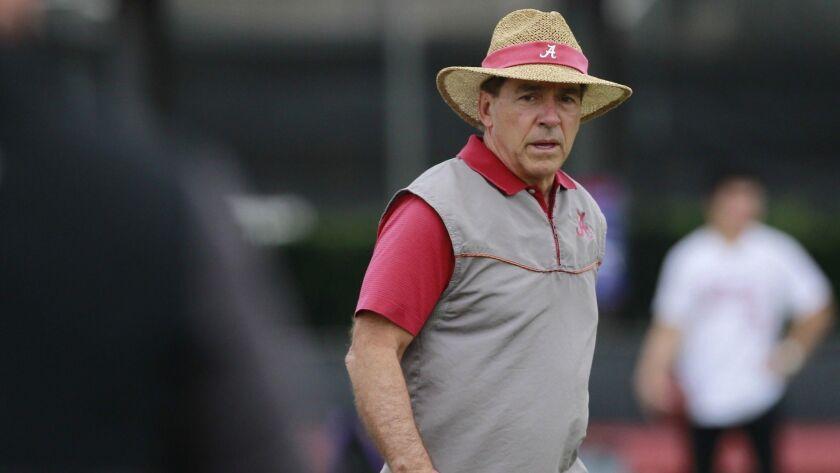 Alabama head coach, Nick Saban walks the field at NCAA college football practice in Miami Shores, Fl