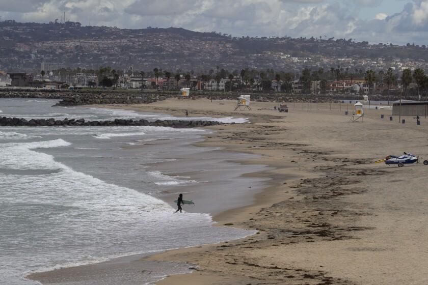 A lone surfer March 24 at Ocean Beach.