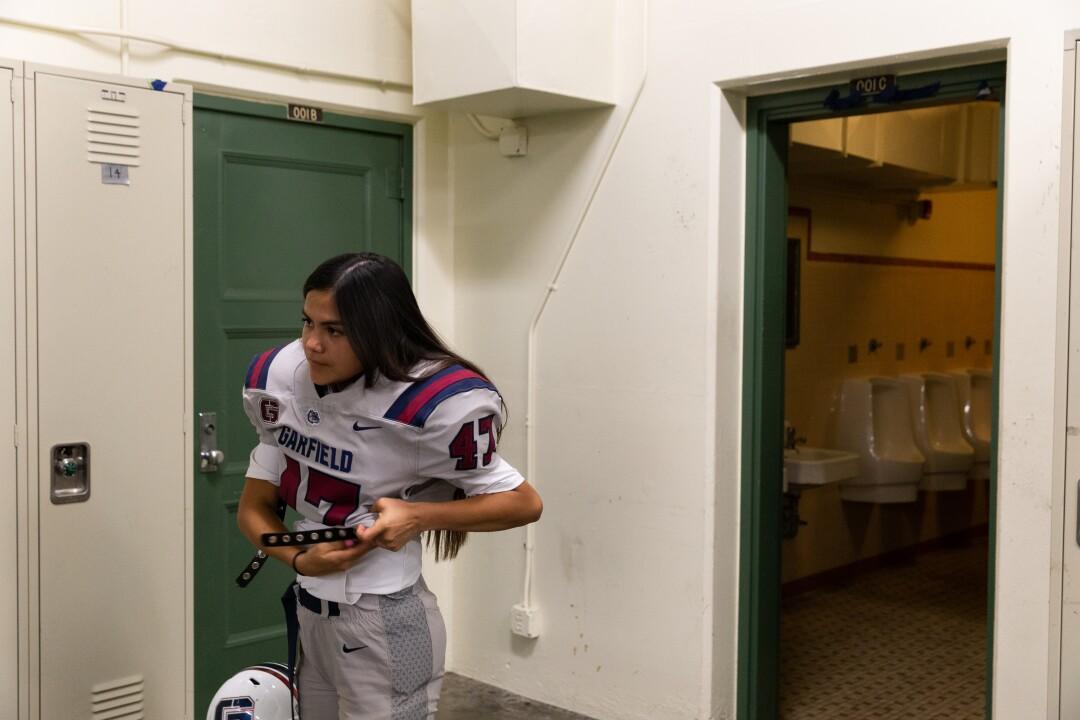 Dalia Hurtado gets ready for a football game