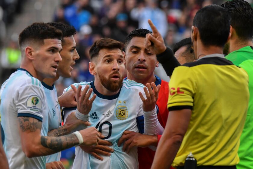 TOPSHOT - Argentina's Lionel Messi (C) talks to Paraguayan referee Mario Diaz de Vivar after he and Chile's Gary Medel (out of frame) were sent off during their Copa America football tournament third-place match at the Corinthians Arena in Sao Paulo, Brazil, on July 6, 2019. (Photo by Nelson ALMEIDA / AFP)NELSON ALMEIDA/AFP/Getty Images ** OUTS - ELSENT, FPG, CM - OUTS * NM, PH, VA if sourced by CT, LA or MoD **