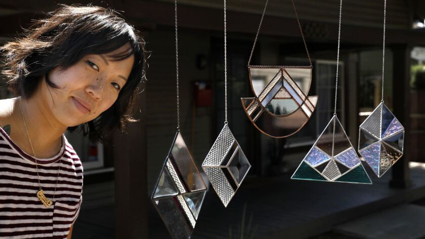 HIGHLAND PARK, CA-OCTOBER 9, 2018: Stained glass artist Janel Foo is photographed with her stained